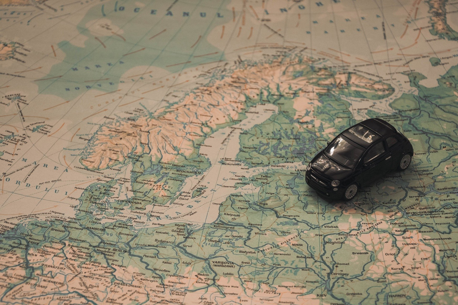 world map with mini car
